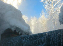 Hot Springs Guide - Liard Hot Springs Waterfall - Photo by Qyd